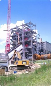Selective demolition of the Ash Grove concrete manufacturing plant in Midlothian, Texas that included removal of multiple structures, kiln's, piers and concrete shear walls with 12,000 lb. hydraulic hammers mounted on 100,000 lb. excavators to make way for new construction.