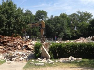 Our excavator finishing tearing down a house in North Dallas.