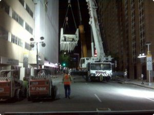 Dismantle of a 45 ton Sky bridge 90' long 12' wide and 60 feet above Ervay Street in downtown Dallas by a 450 ton mobile crane.