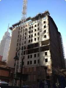 Dismantle of a 17 story building of over 250,00 square feet and 225' feet tall in downtown Dallas was demolished by hand using pneumatic hammers, cutting torches, and Brokk robots. It was once the tallest buildings west of the Mississippi River and to this day is the tallest building to be dismantled in the Dallas, Fort Worth area.