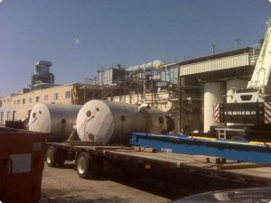Salvage of multiple 10,000 gallon stainless steel toluene storage tanks.
