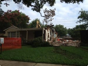 Another shot of our excavator tearing down a house in Preston Hollow.